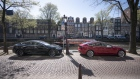 A Tesla Inc. Model 3, right, and a Model S electric automobile recharge at a charging station beside a canal in Amsterdam, Netherlands, on Monday, April 1, 2019. With 5,315 new cars registered, Tesla's Model 3 accounted for 29 percent of the new sales.