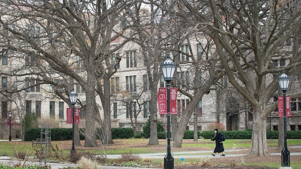 "CHICAGO, IL - NOVEMBER 30: A Pedestrian walks through the Main Quadrangles (Quad) on the Hyde Park Campus of the University of Chicago on November 30, 2015 in Chicago, Illinois. The university president closed the campus today after the university was informed by the FBI that a threat of gun violence was made against the school specifically mentioning the ""campus quad"". (Photo by Scott Olson/Getty Images)"