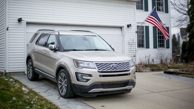 A Ford Motor Co. 2017 Explorer sports utility vehicle (SUV) sits outside a home in South Lyon