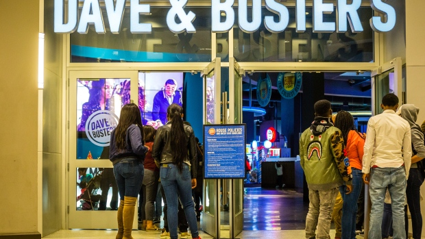 Customers stand in line to enter a Dave & Buster's Entertainment Inc. location in Pelham, New York