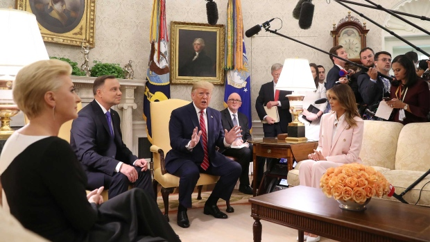 WASHINGTON, DC - JUNE 12: U.S. President Donald Trump and first lady Melania Trump meet with the President of Poland, Andrzej Duda and his wife Agata Kornhauser-Duda, in the Oval Office the White House on June 12, 2019 in Washington, DC. The two leaders are scheduled to attends meetings at the White House before speaking at a Rose Garden news conference. (Photo by Mark Wilson/Getty Images)