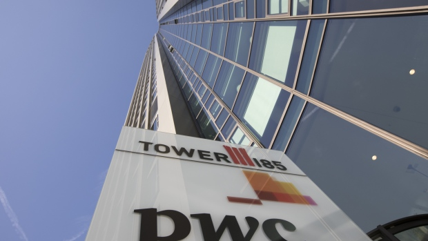 "The PricewaterhouseCoopers LLP logo sits on a sign outside 51-storey skyscraper Tower 185 in Frankfurt, Germany, on Wednesday, Oct. 18. 2017. In a tweet with the hashtag #Brexit, Goldman Sachs Group Inc. Chief Executive Officer Lloyd Blankfein on Thursday hailed ""great meetings"" he had in Frankfurt and said he will spend a lot more time there."