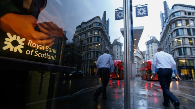 A pedestrian passes a Royal Bank of Scotland Group Plc bank branch in London, U.K., on Wednesday, Feb. 15, 2017. RBS is preparing to cut more than 1 billion pounds ($1.25 billion) of annual operating costs by eliminating jobs and closing branches as it seeks to bolster profitability, said a person with knowledge of the plans.