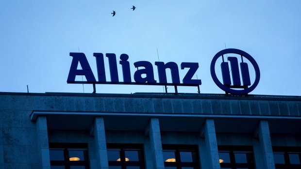 The Allianz SE logo sits on a top of a building in Berlin.