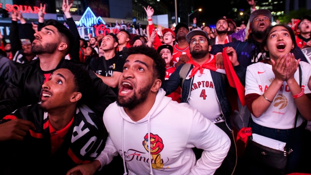 Fans reacts in the finals minute of the game in Jurassic Park as the Toronto Raptors