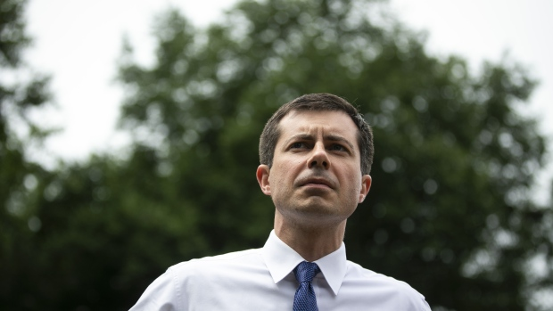 Pete Buttigieg, mayor of South Bend and 2020 presidential candidate, participates in a Moral Witness rally in Washington, D.C., U.S., on Wednesday, June 12, 2019. The Democratic National Committee will select 20 of the unprecedented 23 candidates for the party nomination to take part in the first Democratic presidential debates the forums July 26-27 in Miami. Photographer: Al Drago/Bloomberg