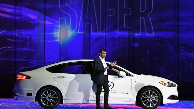 LAS VEGAS, NV - JANUARY 08: Intel Corp. Senior Vice President and CEO and Chief Technology Officer of Mobileye Amnon Shashua speaks in front of a Ford Fusion with Mobileye autonomous driving technology during a keynote address by Intel Corp. CEO Brian Krzanich (not pictured) at CES 2018 at Park Theater at Monte Carlo Resort and Casino in Las Vegas on January 8, 2018 in Las Vegas, Nevada. CES, the world's largest annual consumer technology trade show, runs from January 9-12 and features about 3,900 exhibitors showing off their latest products and services to more than 170,000 attendees. (Photo by Ethan Miller/Getty Images)