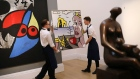LONDON, ENGLAND - APRIL 09: Sotheby's employees pose with a painting entitled 'Still Life with Head', 1976, by Roy Lichtenstein during a UK preview of the 'Impressionist and Modern Art' sale on April 9, 2018 in London, England. The work is expected to fetch between $7-10M USD, when it goes for auction at Sotheby's auction house in New York on May 14, 2018. (Photo by Dan Kitwood/Getty Images)