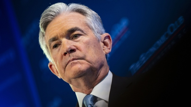 Powell says Fed insulated from politics, wrestling with rate cuts