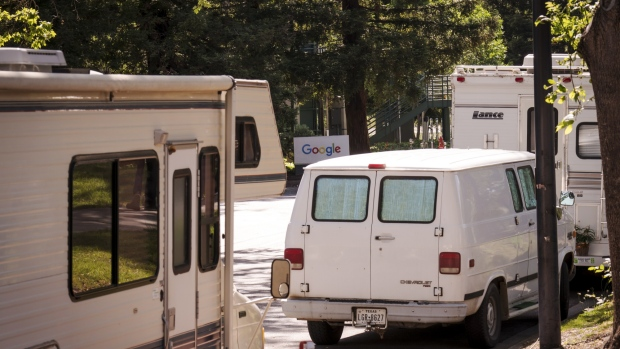 Google LLC signage is seen past recreational vehicles parked on Landings Drive in Mountain View, California, U.S., on Tuesday, May 7, 2019. Mountain View, the epicenter of a Silicon Valley tech boom, is minting millionaires but also fueling a homelessness crisis that the United Nations recently deemed a human rights violation. Thousands of people live in RVs across San Francisco and the broader Bay Area because they can't afford to rent or buy homes.