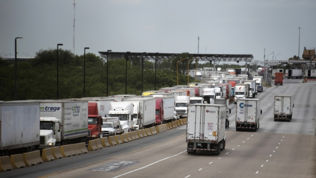 Trucks travel across the World Trade International Bridge in Laredo, Texas, U.S., on Monday, June 10, 2019. Texas, which accounts for more than a third of U.S. trade with Mexico, would be hardest hit by any tariffs on the country.