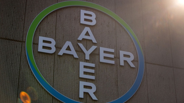 The Bayer AG logo sits on the exterior of the company's pharmaceutical factory in Berlin, Germany, on Wednesday, March 20, 2019. Bayer is moving ahead with plans to sell its animal-health business as large private equity firms such as KKR & Co. and CVC Capital Partners explore bids, according to people familiar with the matter.