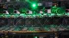Cryptocurrency mining rigs sit on racks at a Bitfarms facility in Saint-Hyacinthe, Quebec, Canada, on Thursday, July 26, 2018.