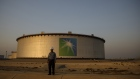 An employee visits the site of crude oil storage tanks at the Juaymah tank farm at Saudi Aramco's Ras Tanura oil refinery and oil terminal in Ras Tanura, Saudi Arabia, on Monday, Oct. 1, 2018