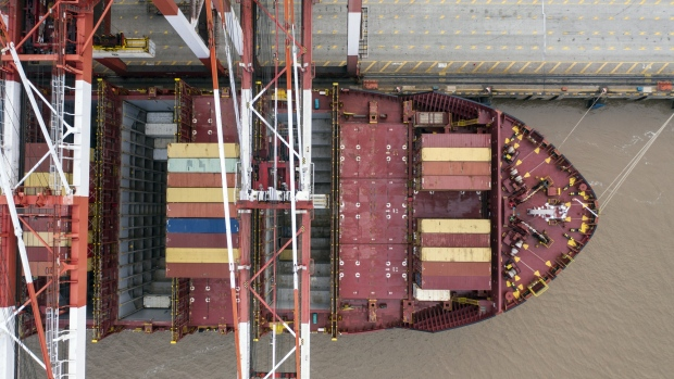 A container ship is docked next to gantry cranes at the Yangshan Deepwater Port, operated by Shanghai International Port Group Co. (SIPG), in this aerial photograph taken in Shanghai, China, on Friday, May 10, 2019. The U.S. hiked tariffs on more than $200 billion in goods from China on Friday in the most dramatic step yet of President Donald Trump's push to extract trade concessions, deepening a conflict that has roiled financial markets and cast a shadow over the global economy.