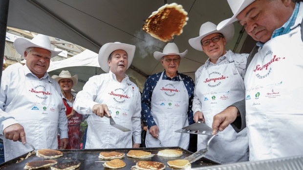 1becc285c4d Kenney and four premiers flip pancakes, don cowboy duds at Calgary ...
