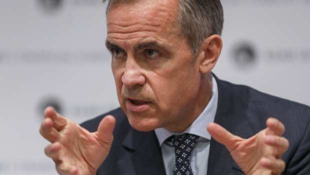 Mark Carney, governor of the Bank of England (BOE), gestures during a news conference following the publication of the Financial Stability Report at the central bank in the City of London, U.K., on Thursday, July 11, 2019.