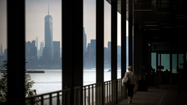 One World Trade Center stands in lower Manhattan as seen from the Empire Outlets mall in the Staten Island borough of New York, U.S., on Friday, July 5, 2019. U.S. stocks fell from records, Treasuries tumbled and the dollar jumped after a strong monthly jobs report clouded the case for Federal Reserve rate cuts.