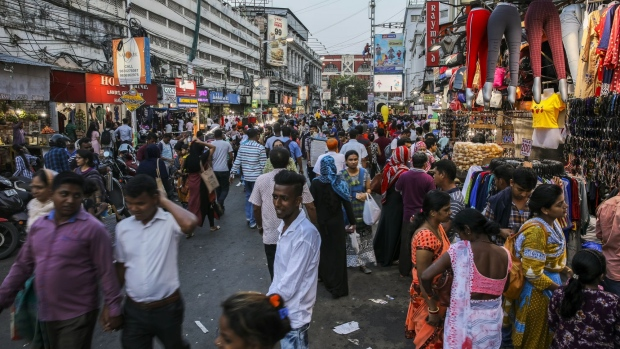 Shoppers walk through the New Market area in Kolkata, India, on Tuesday, April 30, 2019. Prime Minister Narendra Modi is seeking a re-election bid in national elections that began April 11 and takes place in seven phases through May 19.