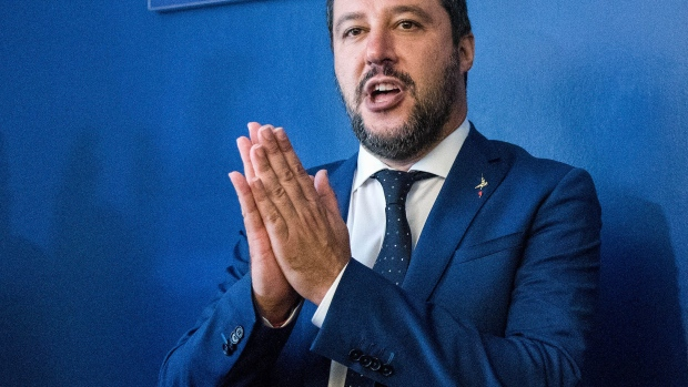 "Matteo Salvini, Italy's deputy prime minister, left, gestures as he poses for photographers with Marine Le Pen, leader of the French nationalist National Rally party, right, ahead of speaking at a news conference at the ""Economic Growth And Social Prospects In A Europe Of Nations"" event in Rome, Italy, on Monday, Oct. 8, 2018. Salvinisaid Europe's real enemy is Jean-Claude Juncker and the Brussels bureaucracy that pushes budget restrictions and open borders."