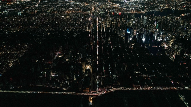 A large section of Manhattan's Upper West Side and Midtown neighborhoods are seen in darkness in New York on July 13.