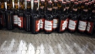 Bottles of beer move along a conveyor belt at the Anheuser-Busch InBev NV Budweiser bottling facility in St. Louis.