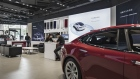 Tesla Motors Inc. electric vehicles sit on display at the company's showroom in Shanghai, China, on Tuesday, Sept. 12, 2017. China will consider granting foreign investors more access into its electric-vehicle market as the world's biggest market for battery-powered automobiles comes out with new policy initiatives to give a fillip to the industry.