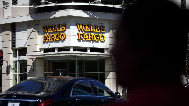 Cars drive past a Wells Fargo & Co. bank branch in Los Angeles.