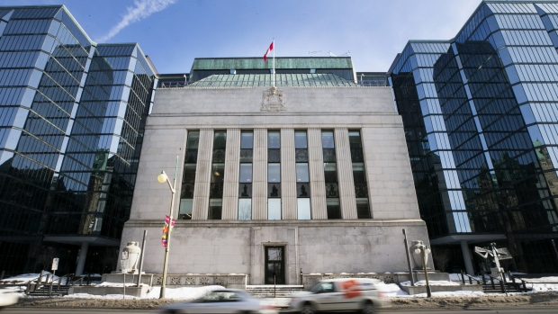 Vehicles drive past the Bank of Canada offices in Ottawa, Ontario, Canada, on Monday, March 20, 2017.