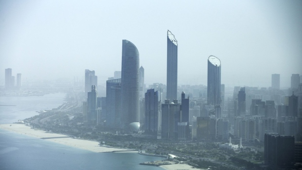 Residential and commercial skyscrapers stand along the coastline in Abu Dhabi.