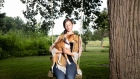 Dog trainer Kelsey Brown and her 16-year-old basenji named Dingo.