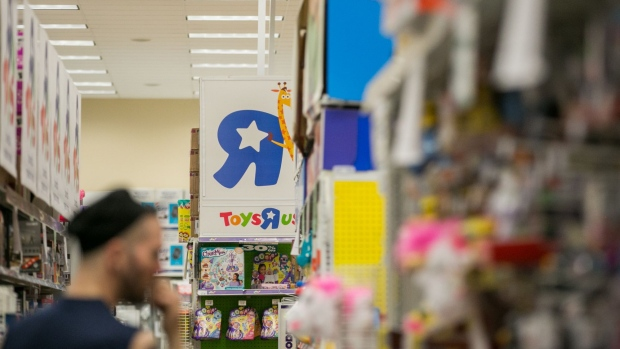 A customer views discounted merchandise displayed for sale at a Toys 'R' Us retail store at Times Square in New York.