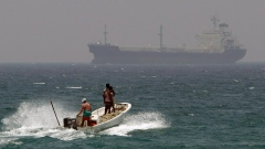 fishermen cross the sea waters off Fujairah, United Arab Emirates, near the Strait of Hormuz.