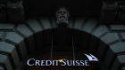 A Credit Suisse logo hangs in the entrance to Credit Suisse Group AG's headquarters in Zurich, Switzerland, on Wednesday, April 24, 2019. Credit Suisse's main trading business swung to a profit after two quarters of losses, as Switzerland's second-largest lender emerged relatively unscathed from what rival UBS Group AG called one of the worst environments in recent history.