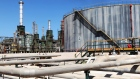 Refining towers and fuel storage tanks are seen at the Zawiya oil refinery near Tripoli, Libya, on Monday, Aug. 29, 2011.