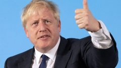 Boris Johnson, former U.K. foreign secretary, gestures while speaking during a U.K. Conservative Party leadership hustings at Carlisle Racecourse, Carlisle, U.K., on Saturday, June 29, 2019. Jeremy Hunt and Johnson, the Conservative Party candidates competing to become U.K. prime minister will battle for votes among the 160,000 grassroots members of the U.K.'s ruling party.