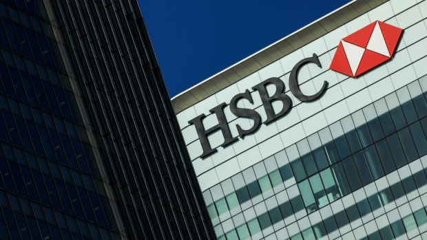 A logo sits on the HSBC Holdings Plc headquarter skyscraper offices in the Canary Wharf business, financial and shopping district in London, U.K., on Tuesday, May 2, 2017. HSBC has appeased investors with $3.5 billion of share buybacks, but after five years of declining revenue analysts are looking for evidence the bank is stabilizing its top line when it reports earnings Thursday.