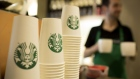 The Starbucks Corp. logo sits on cardboard coffee cups inside a Starbucks Corp. shop in London.