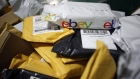 A parcel in eBay Inc. packaging is seen on a conveyor belt with other small parcels at the United States Postal Service.