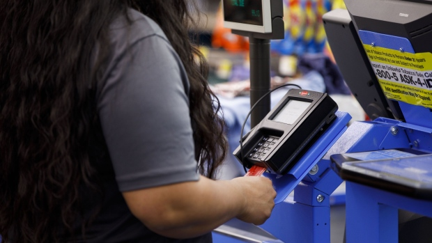 A customer inserts a chip debit card into a credit card terminal at a Wal-Mart Stores Inc. location in Burbank, California, U.S., on Thursday, Nov. 16, 2017.