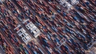 Shipping containers stand at the Qingdao Qianwan Container Terminal in this aerial photograph taken in Qingdao, China, on Monday, May 7, 2018. China's overseas shipments exceeded estimates while imports surged, as the global economy continued to support demand.