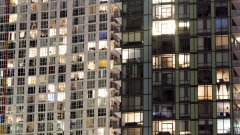 Condominium windows are seen illuminated at night in Toronto, Ontario, Canada.