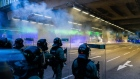 Riot police fire teargas during a protest in Tai Wai on Aug. 10. Photographer: Billy H.C. Kwok/Getty Images