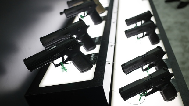 SIG P320 handguns are displayed at the SIG Sauer GmbH booth on the exhibit floor during the National Rifle Association (NRA) annual meeting in Louisville, Kentucky, U.S., on Friday, May 20, 2016. The nation's largest gun lobby, the NRA has been a political force in elections since at least 1994, turning out its supporters for candidates who back expanding access to guns.
