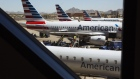 American Airlines Group Inc. planes stand at Phoenix Sky Harbor International Airport in Phoenix.