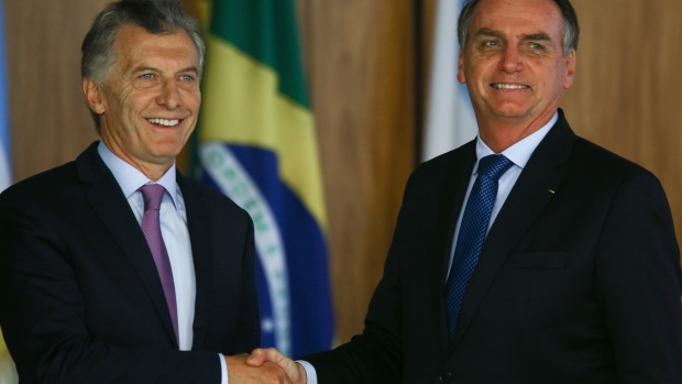 Jair Bolsonaro, Brazil's president, shakes hands with Mauricio Macri, Argentina's president, left, during a joint news conference in Brasilia, Brazil, on Wednesday, Jan. 16, 2019. South America's two largest countries are more united than ever, Argentine President Mauricio Macri declared during an official visit to Brasilia that sought to reset relations with President Jair Bolsonaro after an awkward start. Photographer: Andre Coelho/Bloomberg