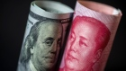 U.S. one-hundred dollar and Chinese one-hundred yuan banknotes. Bloomberg/Paul Yeung