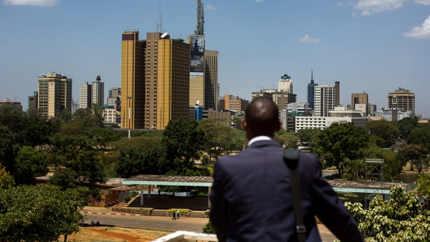 A man stands and looks out across the city skyline in Nairobi, Kenya.