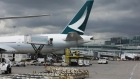 A Cathay Pacific Airlines Ltd. plane sits at a gate at Toronto Pearson International Airport (YYZ) in Toronto, Ontario, Canada, on Monday, July 22, 2019. In 2018, 49.5 million passengers traveled through Pearson on 473,000 flights.