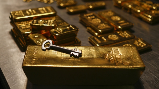 A safety deposit box key rests on a gold bar weighing 12.5 kilograms in the precious metals vault at Pro Aurum KG in Munich, Germany, on Wednesday, July 10, 2019. Gold rose for a third day after the Federal Reserve indicated that it's preparing to cut interest rates for the first time in a decade as the global economy slows.